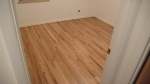 We decided to save the floors in the front bedrooms.  They were sanded and refinished with a water based clear coat.