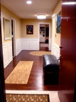 Front entryway...Finally complete.  New lighting, new floors, wainscot, paint, trim, and artwork to boot.