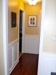 The small hallway leading to front two bedrooms